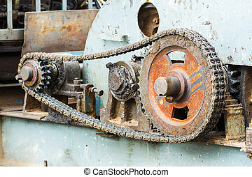 Gear and chain - Close up dirty old gear and chain on piling...
