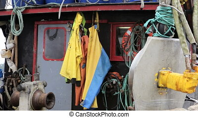 Gear on Boat Deck - Equipment and rain gear hanging on an...