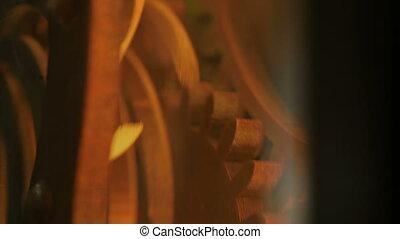 Gear wheels system rotation, multicolor light. Close up...