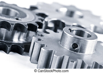 Gears - Interlocking industrial metal gears isolated on...