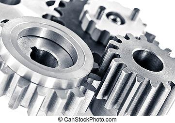 Gears - Interlocking industrial metal gears isolated on ...