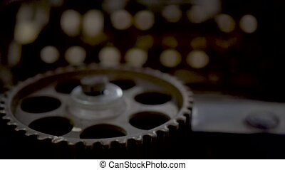 gears of the engine in the foreground, dolly shot