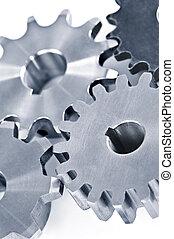 Gears - Interlocking industrial metal gears isolated on...
