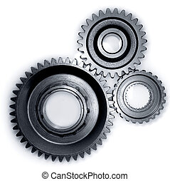 Three gears meshing together on plain background