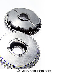 Gears - Two metal gears together on plain background