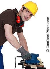gebruik, man, elektrisch, sander