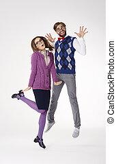 Geek couple goofing around in studio