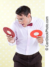 Geek with Vinyl Record - Man looking at vinyl record with...