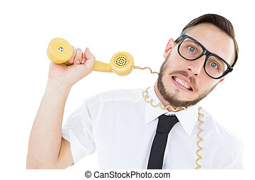 Geeky businessman being strangled by phone cord on white...