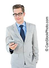 Geeky businessman sending a text