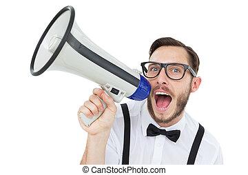 Geeky businessman shouting through megaphone on white...
