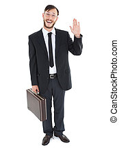 Geeky businessman waving at camera on white background