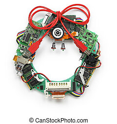 geeky christmas wreath made by old computer parts isolated on white background