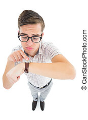 Geeky hipster pointing to his watch