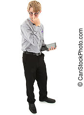 Geeky nerd teen with electronic notepad over white with clipping path.