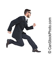 Geeky young businessman running mid air on white background