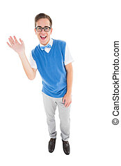 Geeky young hipster waving at camera on white background