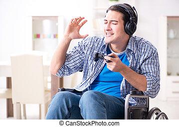gehandicapte man, gespeel computerspelletjes, gedurende, rehabilitatie