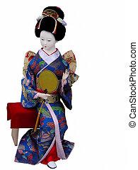 Geisha doll sitting - Geisha doll with paper fan sitting on ...