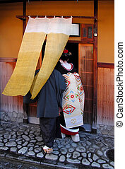 Geisha entering in a tea house - Geisha entering in a ...
