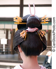 Geisha hairstyle - Close up of an interesting and unusual ...