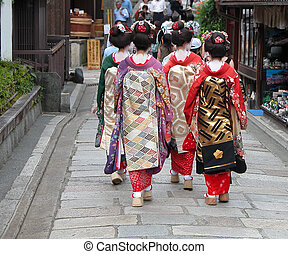"""A group of """"one day geisha"""" Japanese girls, walking in a very traditional area of Kyoto City, Japan A group of """"one day geisha"""" Japanese girls, walking in a very traditional area of Kyoto City, Japan"""