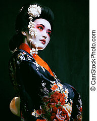 geisha in kimono on black - Young beautiful asian woman's...