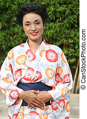 Geisha - Portrait of a beautiful Japanese woman dressed in ...
