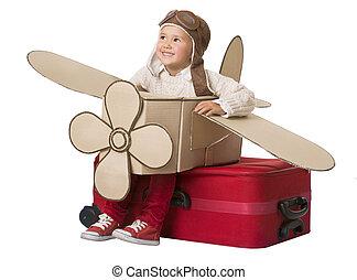 geitje, reizen, op, het vliegtuig van het stuk speelgoed, kind, zittende , op vakantie, koffer, bagage, vlieg, als, schaaf, baby, spelend, piloot