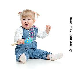 geitje, spelend, met, muzikalisch, toys., vrijstaand, op wit, achtergrond