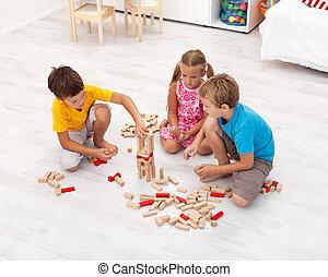 geitjes, spelend, met, houten blokken