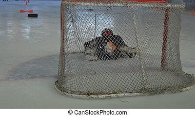 geitjes, spelende hockey