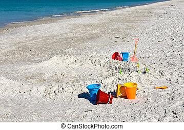 geitjes, zet op het strand speelgoed