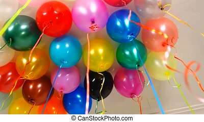 gel balloons weighing on a ceiling before a holiday