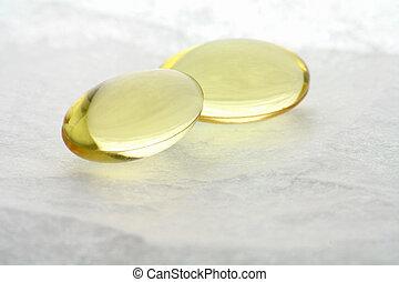 gel pills - yellow gel pills close up