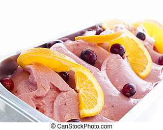 Gourmet sweet orange and cranberry gelato on white background.