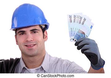 geld, de arbeider van de bouw, op, vasthouden