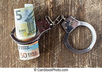 geld, handcuffs.