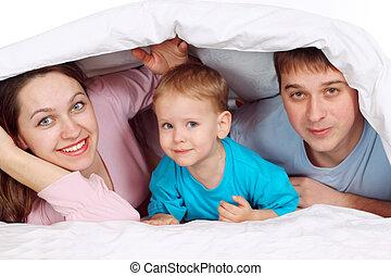 gelukkige familie, het liggen