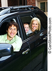 gelukkige familie, in auto