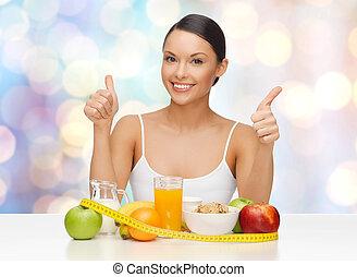 gelukkige vrouw, met, gezond voedsel, het tonen, beduimelt omhoog