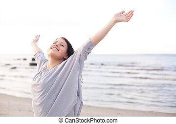 gelukkige vrouw, stretching, haar, armen, om van te...