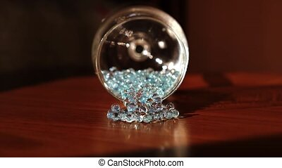 Gems come out of a glass chalice