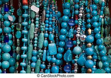 Handcrafted blue gemstone jewelry on open air market
