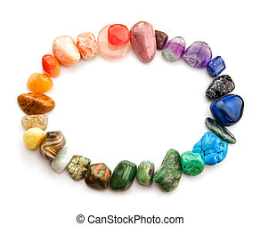 Semiprecious gemstones of various colors in oval border, isolated.