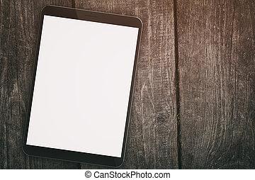 genérico, computadora personal tableta, con, pantalla en blanco, en, madera, tabla