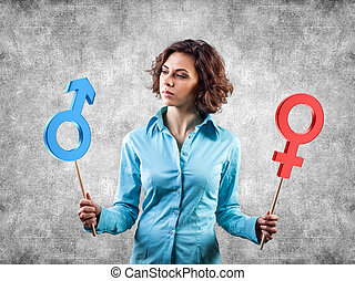Two symbols of a different gender in hands of the girl