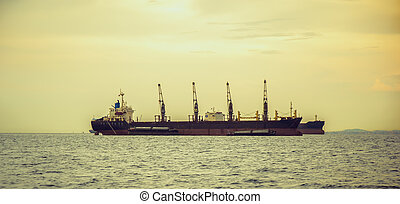 General cargo ship on sunset.
