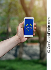 General Data Protection Regulation (GDPR) on smartphone in the man's hand.