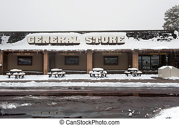 The front of a general merchandise store in the snowy, cold Arizona mountains.